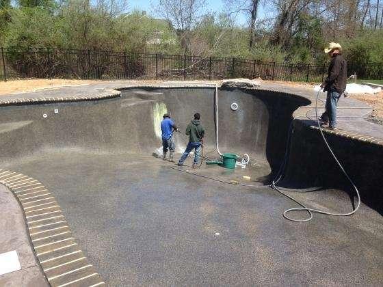 Finishing River Rok Plaster installation. New Pool, 2013