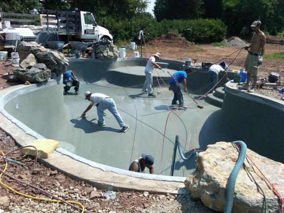 Plastering a pool with River Rok